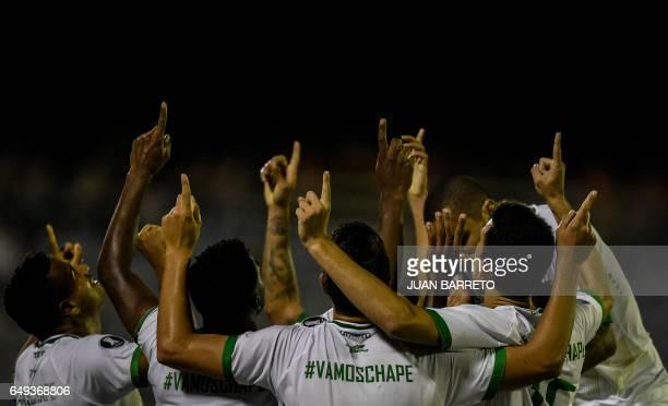 TOPSHOT Brazilian Chapecoense players celebrate after scoring a gaol against Venezuela's Zulia during their Copa Libertadores football match in...