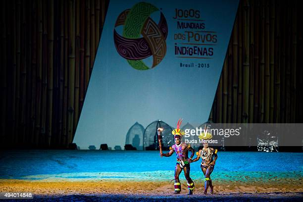 Brazilian Chavantes indigenous carry a torch during the opening ceremony of the first World Games for Indigenous Peoples on October 23 2015 in Palmas...