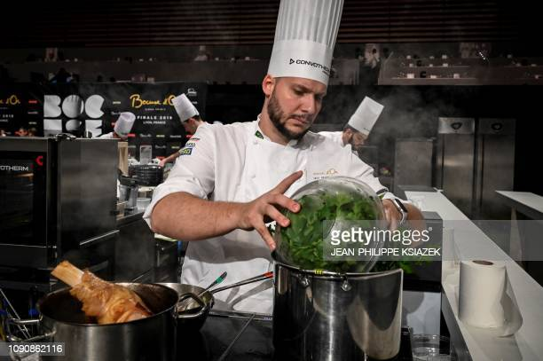 Brazilian chef Luis Filipe de Acevedo e Souza competes in the final event of the Bocuse d'Or International culinary competition during SIRHA an...