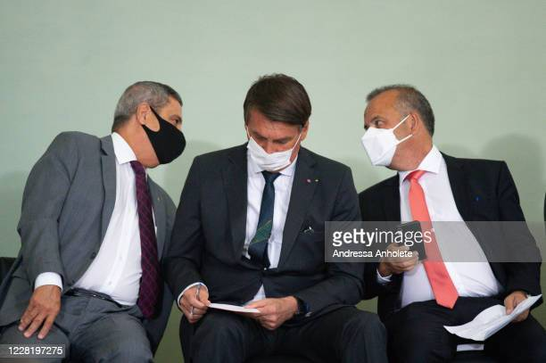 Brazilian Chief of Staff General Walter Souza Braga Netto, President of Brazil Jair Bolsonaro and Minister of Regional Development, Rogério Marinho...