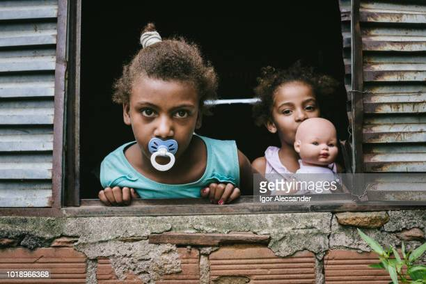 brazilian children at the window - favela stock pictures, royalty-free photos & images