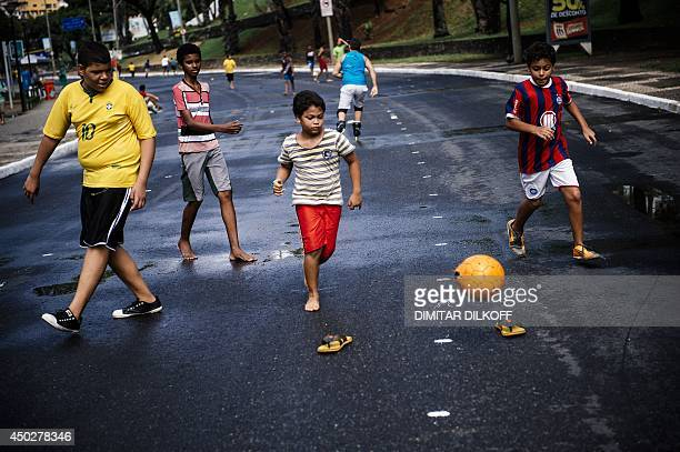 Brazilian children play football on a street near the Fonte Nova Arena stadium in Salvador on June 8 ahead of the 2014 FIFA World Cup in Brazil AFP...