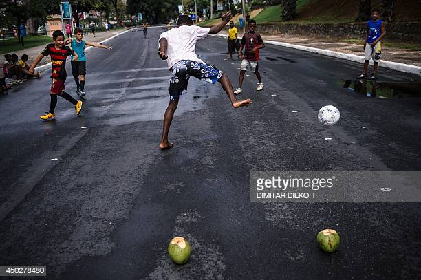 Brazilian children play football on the street near the Fonte Nova Arena stadium in Salvador on June 8 ahead of the 2014 FIFA World Cup in Brazil AFP...