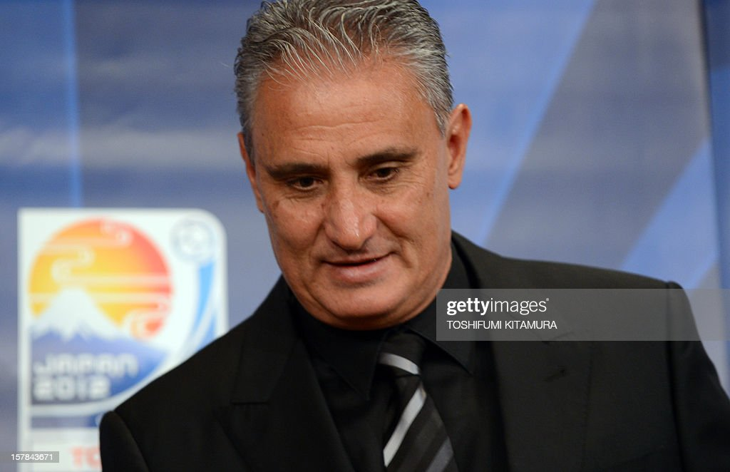Brazilian club team Corinthians head coach Tite takes a seat to start their press conference at a hotel in Nagoya, Aichi prefecture while participating in the FIFA Club World Cup in Japan 2012 on D...