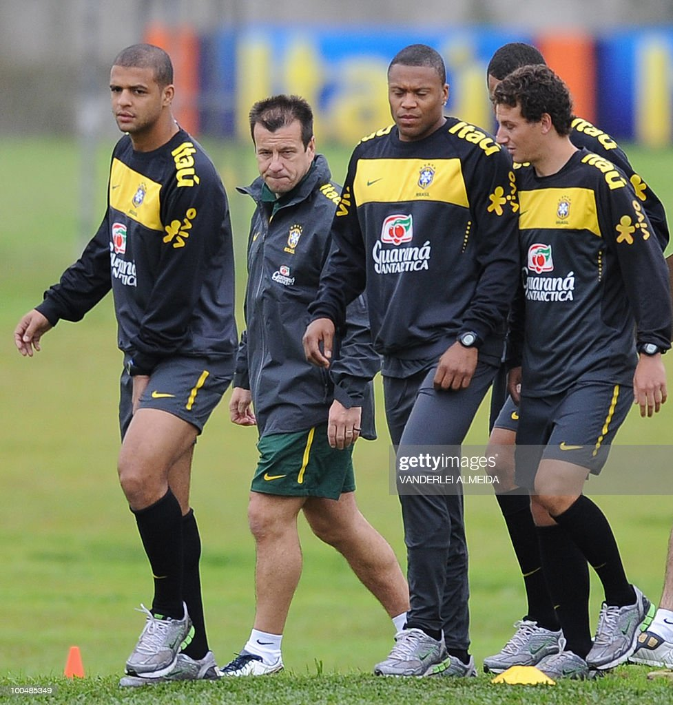 Brazilian coach Dunga (2nd-L) looks at his players (L to R) Felipe Melo, Julio Baptista and Elano during a training session in Curitiba, southern Brazil on May 24, 2010. Brazil, five-time world champion, is among the favourites for the South Africa 2010 World Cup which starts on June 11th. The 'Selecao' have been drawn in Group G with North Korea, Ivory Coast and Portugal.