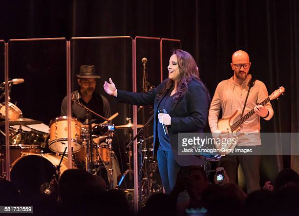 Brazilian composer and singer Ana Carolina performs with her band, including Leonardo Reis on drums and Marcelo Vieira on electric bass guitar, at a...