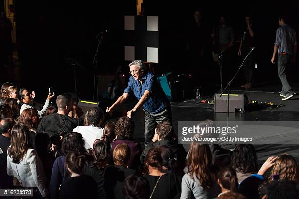 Brazilian composer musician Caetano Veloso performs greets fans at the end of a concert during the 2014 Next Wave Festival at the BAM Howard Gilman...
