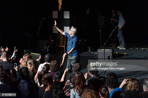 Brazilian composer & musician Caetano Veloso performs greets fans at the end of a concert during the 2014 Next Wave Festival at the BAM Howard Gilman...