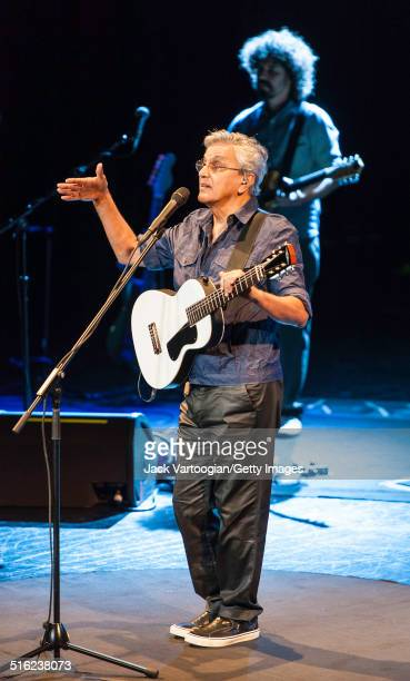 Brazilian composer musician Caetano Veloso performs onstage with his band at a concert during the 2014 Next Wave Festival at the BAM Howard Gilman...