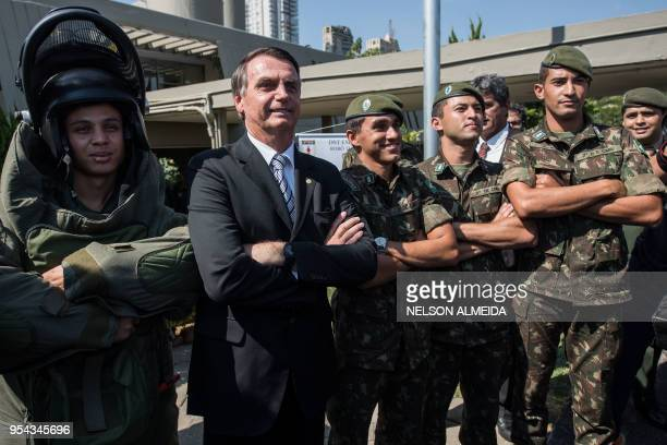 Brazilian congressman and presidential canditate for the next election Jair Bolsonaro poses for pictures with militaries during an military event in...