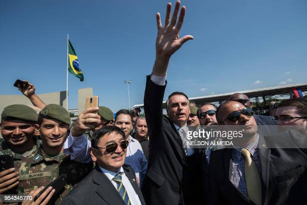 Brazilian congressman and presidential canditate for the next election Jair Bolsonaro waves to the crowd during a military event in Sao Paulo Brazil...