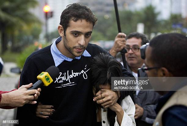 A Brazilian couple relatives of a passenger onboard illfated Air France flight AF447 leave a hotel after being informed about the accident in Rio de...