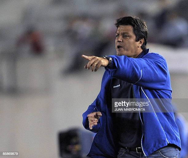 Brazilian Cruzeiro's coach Adilson Batista gestures during their Copa Libertadores 2009 Group 5 football match against Argentina's Estudiantes de La...