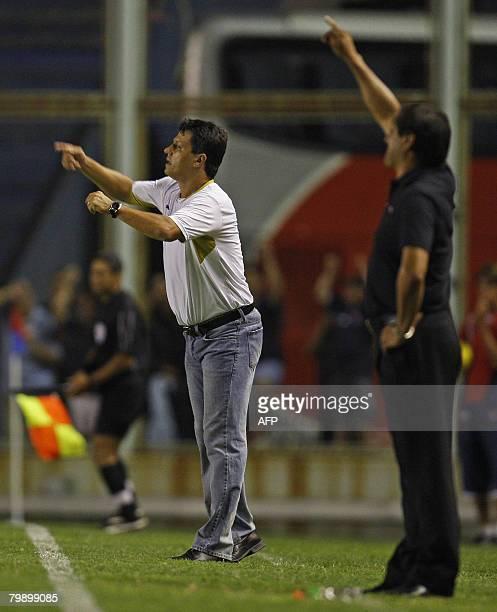Brazilian Cruzeiro's team coach Adilson Batista and his colleague Ramon Diaz of San Lorenzo give instructions to his player during their Libertadores...