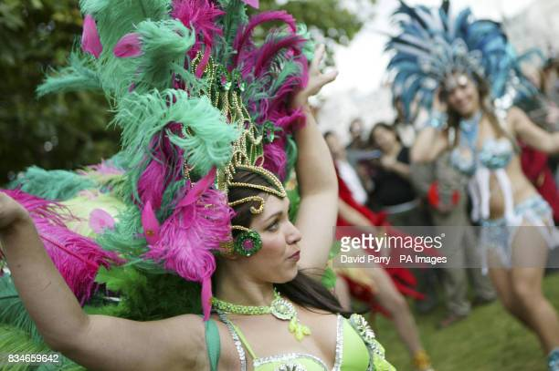 A Brazilian dancer from the Latin Fusion Dance Company help celebrate the 50th Anniversary of Bossa Nova on the South Bank of the River Thames in...