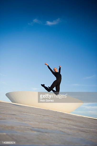 brazilian dancer jumping in mid-air outdoors - distrito federal brasilia stock pictures, royalty-free photos & images
