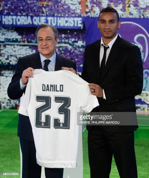 Brazilian Danilo poses with Real Madrid's President Florentino Perez as they hold Danilo's jersey during his presentation as new player of Real...