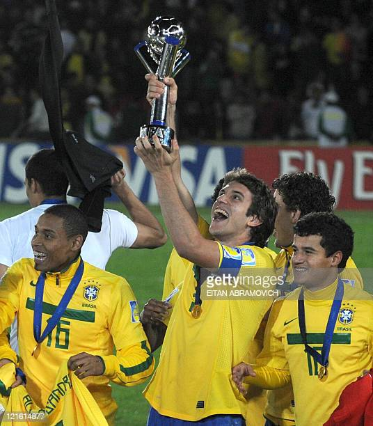 Brazilian defender Gabriel Silva defender Bruno Uvini and midfielder Philippe Coutinho celebrate with the trophy after beating Portugal in the FIFA...