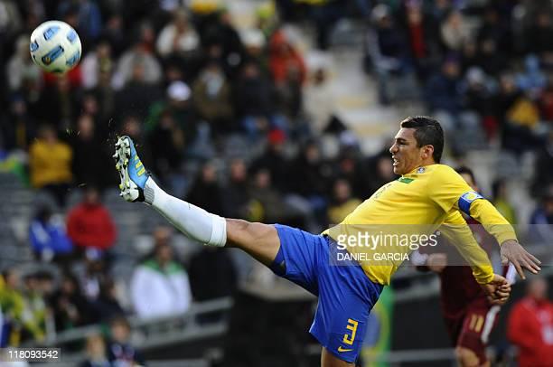 Brazilian defender Lucio kicks the ball during a 2011 Copa America Group B first round football match against Venezuela held at the Ciudad de La...