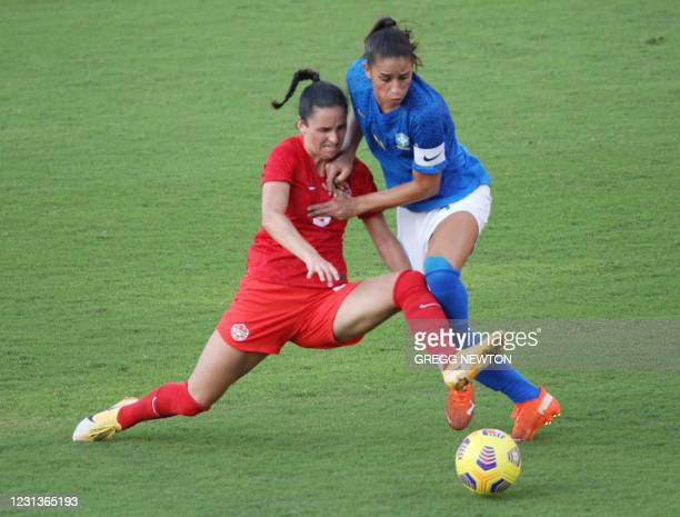 Brazilian defender Rafaelle clears the ball away from forward Evelyne Viens of Canada during their SheBelieves Cup international soccer tournament...