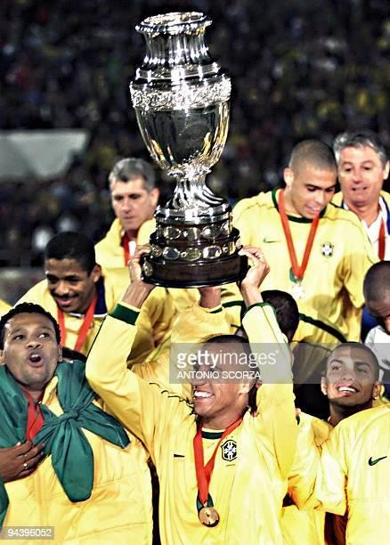 Brazilian defender Roberto Carlos raises the Copa America 18 July in Asuncion Brazil defeated Uruguay 30 to win the Copa America soccer tournament...