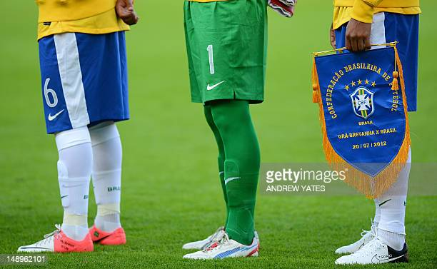 Brazilian defender Thiago Silva holds a pennant before their London 2012 Olympic games warm up football match between Great Britain and Brazil at the...