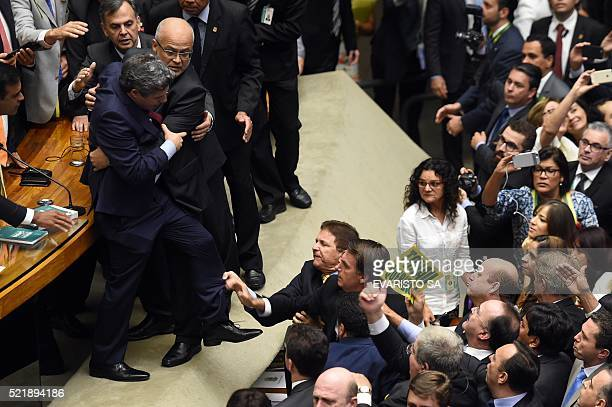 Brazilian Deputies fight during a session to discuss the admissibility of the impeachment request of President Dilma Rousseff in Brasilia on April...