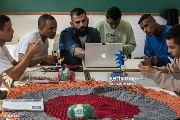 Brazilian designer and craftsman Gustavo Silvestre teaches crochet to inmates as part of 'Ponto Firme' project in the Adriano Marrey maximum security...