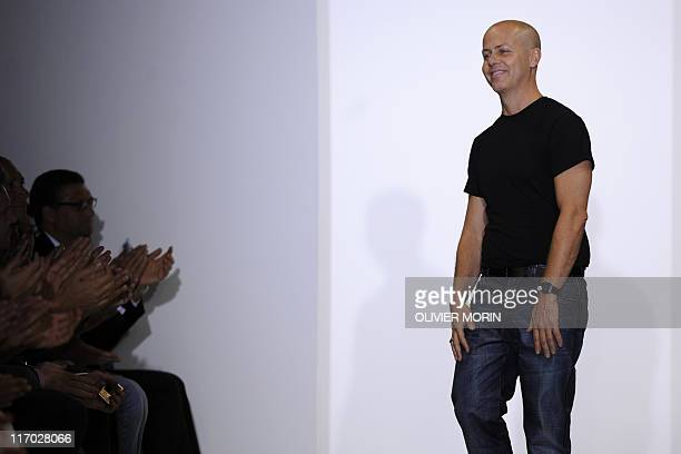 Brazilian designer Francisco Costa acknowledges the audience at the end of the Calvin Klein Collection SpringSummer 2012 Menswear collection on June...