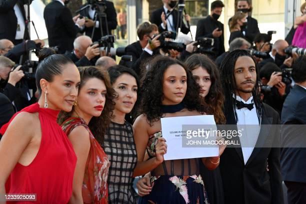"Brazilian director Anita Rocha da Silveira arrives with the cast of her film ""Medusa"", Brazilian actors Bruna Linzmeyer , Mariana Oliveira , Lara..."