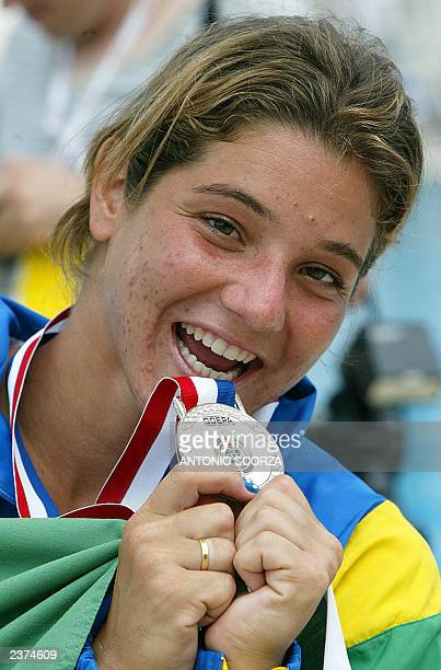 Brazilian diver Juliana Veloso holds her silver medal during the women's 10M platform podium ceremony 06 August 2003 at the 2003 Pan American Games...