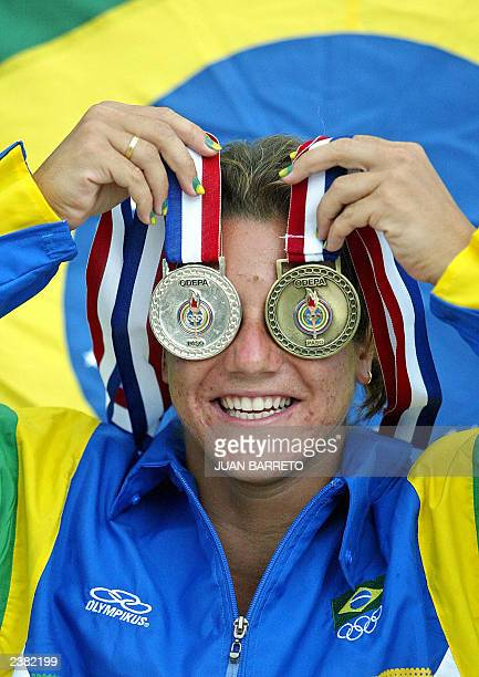 Brazilian diver Juliana Veloso shows her medals 08 August 2003 won at the XIV Pan American Games in Santo Domingo Dominican Republic AFP PHOTO/Juan...