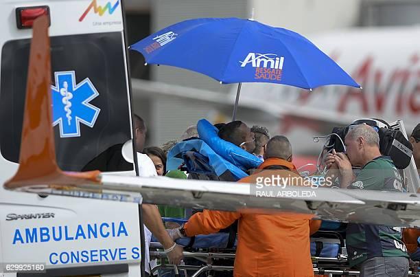 Brazilian doctors carry Chapecoense football player and plane crash survivor Helio Neto to a plane departing to Brazil in Rionegro Antioquia...
