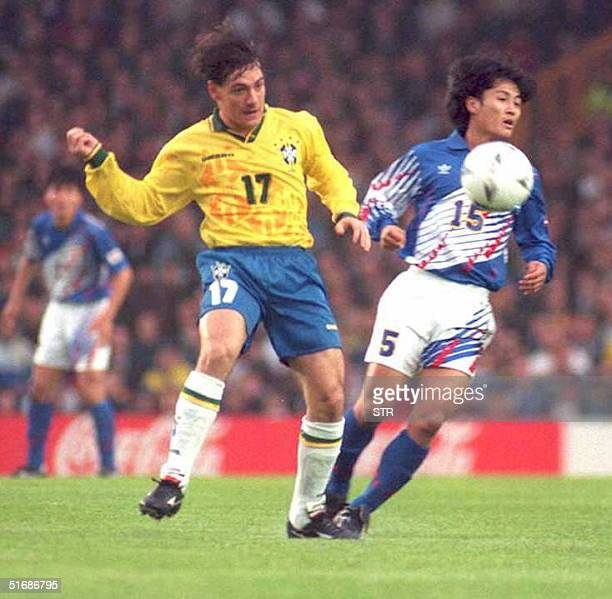 Brazilian Doriva fights for the ball with Japanese Kazuyoshi Miura 06 June during their Umbro Cup match in Liverpool Barzil won the match 30
