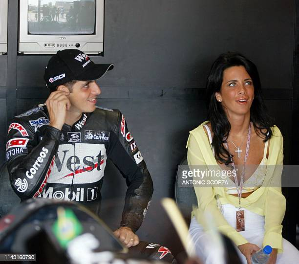Brazilian driver Alexandre Barros of Honda Pons and his wife Patricia sit in the pits of the Nelson Piquet race track preparing for the MotoGP...