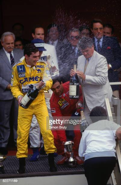 Brazilian driver Ayrton Senna celebrating his victory at the Monaco Grand Prix for Lotus Honda 31st May 1987 Third place Ferrari driver Michele...