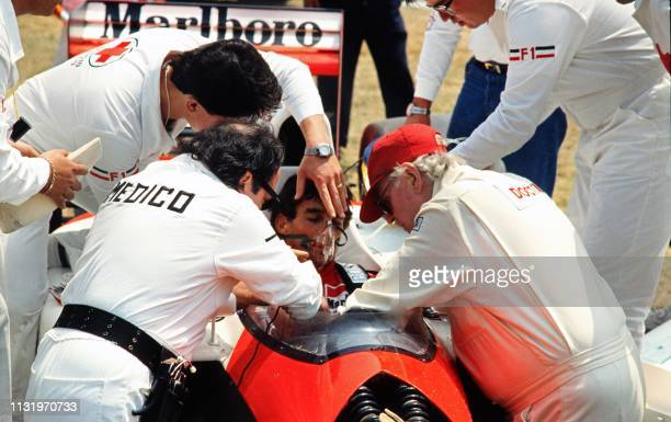 Brazilian driver Ayrton Senna gets medical help on March 20 1992 after crashing during the first practice run of the Mexican Grand Prix Senna was...