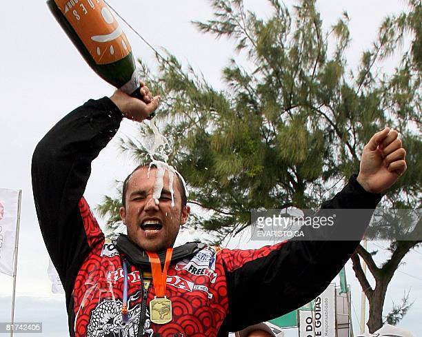 Brazilian driver Jose Helio celebrates his victory in the Rally of Sertoes 2008 in the city of Natal Rio Grande do Norte State on June 27 2008 AFP...