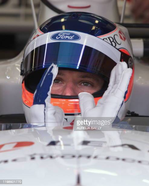 Brazilian driver Rubens Barrichello sits in his StewartFord in the pits during the first free practice session in Spielberg 23 July 1999 two days...