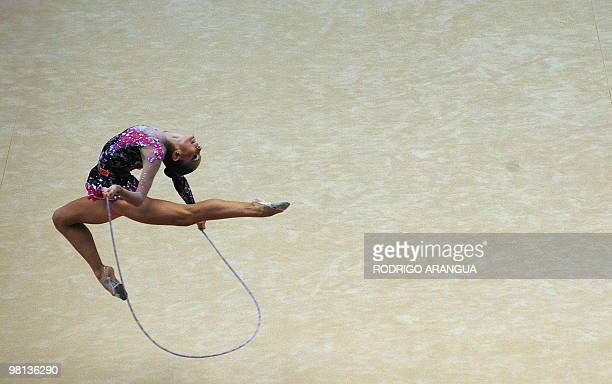 Brazilian Eliane Sampaio competes in the individual rope competition of the rhythmic gimnastics during the IX South American Games in Medellin...