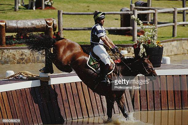 Brazilian equestrian Luiz Augusto Faria competes on Hunefer for the Brazil team to finish in 6th place in the Team eventing equestrian event at the...