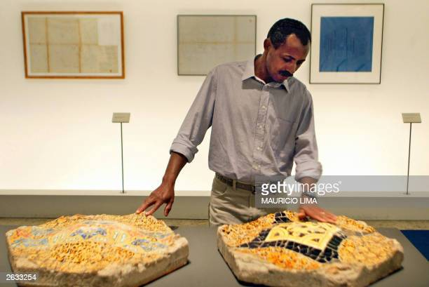 Brazilian Estevao Silva da Conceicao native of the poor state of Bahia watches the hexagons of the Parc Guell during his visit to an exposition at...
