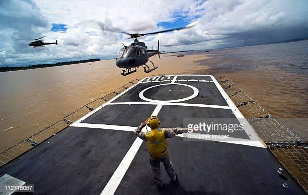A Brazilian Eurocopter prepares to land aboard a Brazilian navy hospital ship.