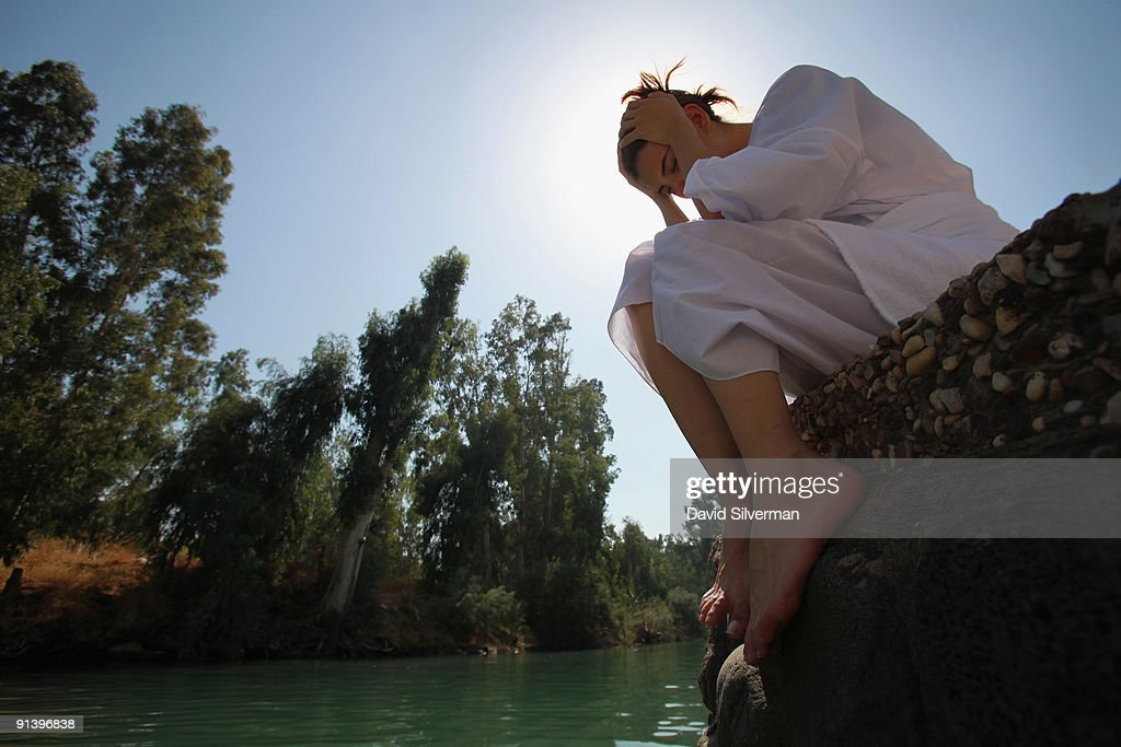 A Brazilian Evangelist Christian prays after she was baptised in the Jordan River on October 4, 2009 at Yardenit in northern Israel. Hundreds of worshippers from northern Brazil were immersed in the biblical river as part of their pilgrimage to the Holy Land.