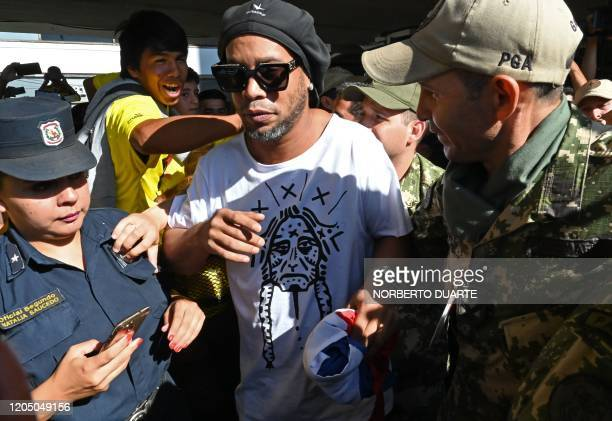 Brazilian exfootball star Ronaldinho Gaucho arrives at Silvio Pettirossi International Airport in Luque near Asuncion on March 4 2020 Ronaldinho...
