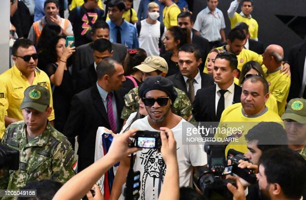 TOPSHOT Brazilian exfootball star Ronaldinho Gaucho arrives at Silvio Pettirossi International Airport in Luque near Asuncion on March 4 2020...