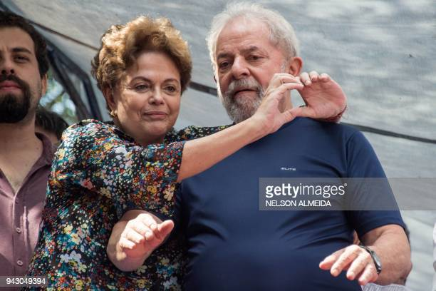 Brazilian expresident Luiz Inacio Lula da Silva and Brazilian former president Dilma Rousseff gesture after during a Catholic Mass in memory of...