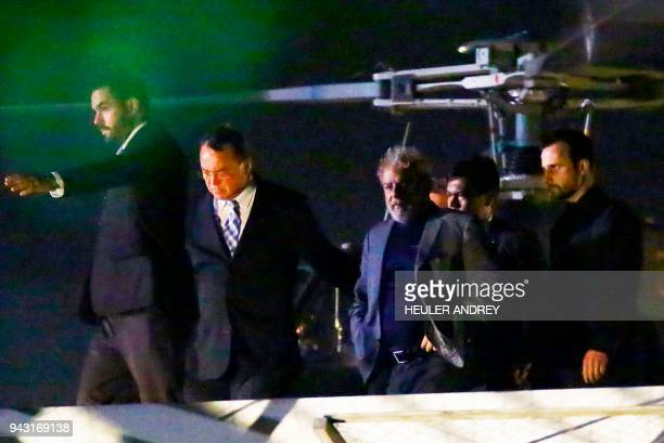 Brazilian expresident Luiz Inacio Lula da Silva arrives at the Federal Police headquarters where he is due to serve his 12year prison sentence in...