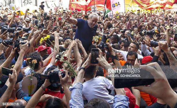 Brazilian expresident Luiz Inacio Lula da Silva is carried by supporters after attending a Catholic Mass in memory of his late wife Marisa Leticia at...
