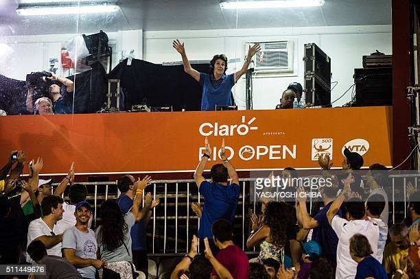Brazilian ex-tennis player who won 19 major titles Maria Esther Andion Bueno waves to crowd during the men's singles semi-final match between Pablo...